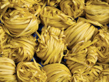 Clusters of Yellow Egg Noodles at Street Side Stall