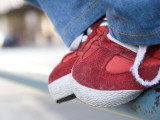 Red Tennis Shoes on Railing