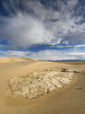 Huge Cumulus Cloud over Eroded and Cracked Clay Formation at Mesquite Flat Sand Dunes
