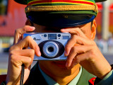 Guard Using His Camera on China's National Day in Tianamen Square