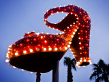 Red Neon Shoe Glowing at Dusk Along Fremont Street