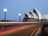 Light Trailing under Harbour Bridge with Sydney Opera House Beyond