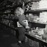 Toddler in Candy Aisle of Store
