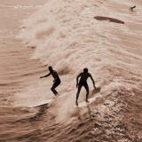 Men Surfing Waves