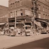 Street Scene of People at Small Shops in Spanish Harlem in New York