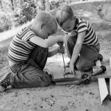 Two Boys Playing With Wooden Tools
