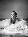 Young Woman Lying in Surf  Laughing