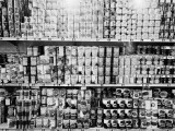 Rows of Shelves Staked With Canned Goods in Supermarket