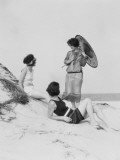 Three Young Women on Beach  Two in Swim Suits  Other Wearing Dress and Carrying a Parasol