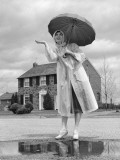 Woman in Raincoat and Rubber Boots Over Pumps