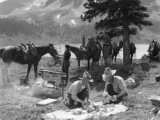 Two Men  Cowboy Guides  Make Campfire and Prepare Food