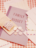 Family Budget Book  Payroll Envelope  Banknotes and Coins on Table