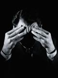 Shadowed Man With Headache  Holding Forehead