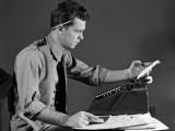 Man in Office at Adding Machine