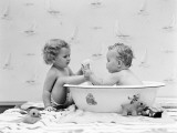 Baby Boy Sittings in Wash Tub  Washing Feet of Girl Sitting Outside of Tub