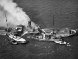 Fireboats Dousing Fire on Large Tanker in Water