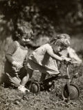Little Boy and Girl Playing With Bicycle
