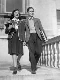 Teen Couple With Books Walking Outside School