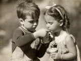 Boy Gives Ice Cream To Sister