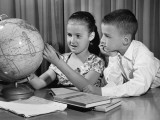 Boy and Girl Looking at Globe