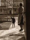 Mother on Porch Seeing Son Off To School  Rear View