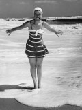 Woman Standing in Shallow Water at Ocean