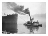 Tugboat Elf Hauling the Pansa Through the Thea Foss Waterway