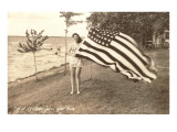 Woman on Shore Holding Flag