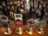 England  London  Beer Pump Handles at the Bar Inside Tradional Pub