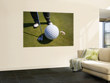 Man Playing Golf with Oversized Ball
