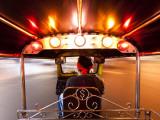Tuk Tuk or Auto Rickshaw in Motion at Night  Bangkok  Thailand