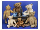 A Selection of Teddy Bears around a Black Painted Tinplate Toy Stove