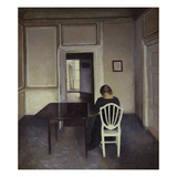 Interior with a Woman Seated on a White Chair