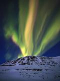 Aurora Borealis over Toviktinden Mountain in Troms County  Norway