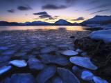 Ice Flakes Drifting Against the Sunset in Tjeldsundet Strait  Troms County  Norway