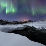 Aurora Borealis over Blafjellelva River in Troms County