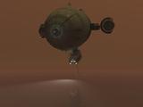 Illustration of a Blimp Towing a Sensor Through Liquid Ethane on Titan