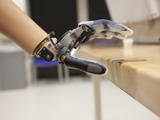 A Patient Performs Functional Tests with the Proto 1 Arm