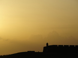 Morro Fortress Silhouetted Against a Sunset Sky