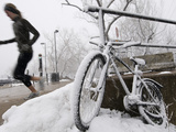Spring Snow on a Bike and a Runner at the University of Colorado