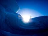 A Hiker Explores an Iceberg Frozen into the Sound Near Axel Heigburg