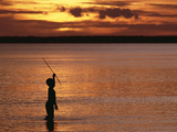 Young Boy Spear Fishing at Sunset in the Mouth of the Kikori River Delta  Papua New Guinea