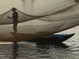 A Vietnamese Fisherman Tending His Nets