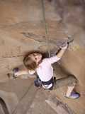 A Young Girl Rock Climbing