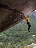 A Climber Scales a Route on Seperate Reality  a Hanging Roof Crack