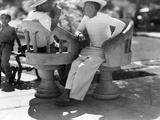 Two Men Talk in One of Merida's Plazas