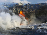 Steam Rises as Lava Flows into the Sea from a Lava Tube