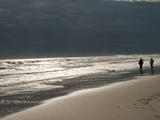 A Couple on the Atlantic Shoreline and Sunlight Reflections