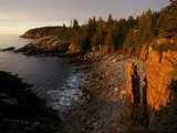 The First Rays of Sunrise on Monument Cove and its Namesake Rock Pillar