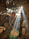 A Woman Makes Injera Bread from a Nutritious Grain